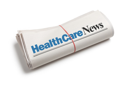 HealthCare News,Newspaper roll with white background Stockfoto