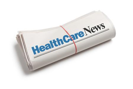 HealthCare News,Newspaper roll with white background Archivio Fotografico