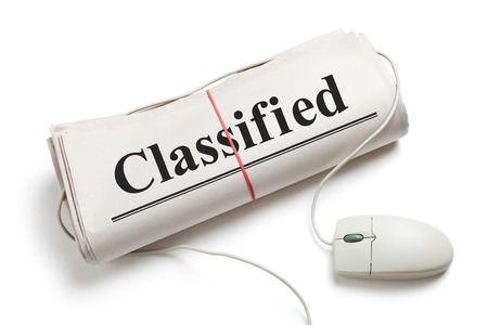 Classified, Computer mouse and Newspaper Roll with white background photo