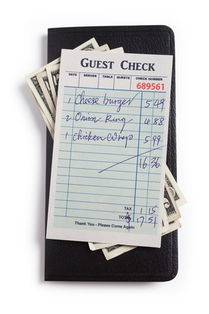 Guest Check and dollar, concept of restaurant expense  photo