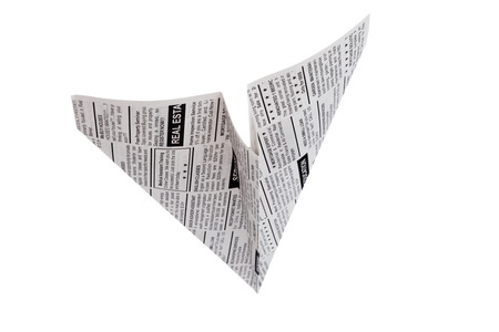 Fake Newspaper Airplane, Classified Ad, business concept  photo