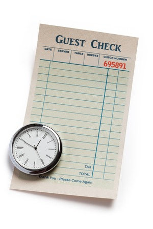 Guest Check and clock, concept of restaurant expense  photo