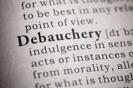 Fake Dictionary, Dictionary definition of the word debauchery  Stock Photo