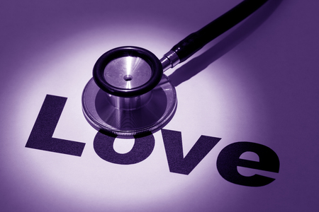 stethoscope and word love, concept of  love issues Stock fotó