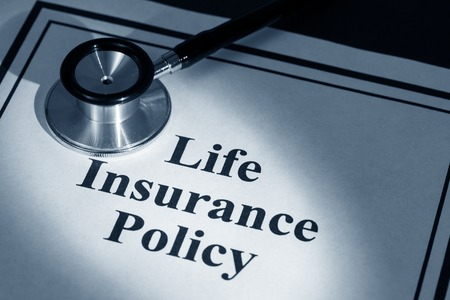 stethoscope and life insurance policy,  Stock fotó