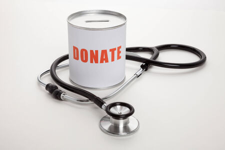 Stethoscope and Donation box, concept of Charity work