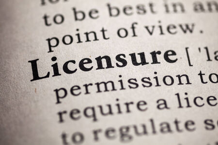 printing out: Fake Dictionary, definition of the word licensure  Stock Photo