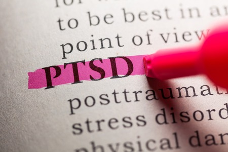 word PTSD highlighted on pink