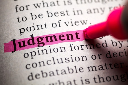 word judgment highlighted on pink