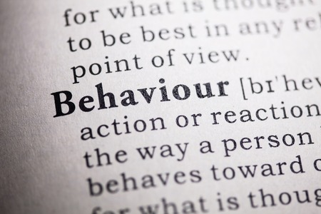 printing out: Fake Dictionary, Dictionary definition of the word behaviour  Stock Photo