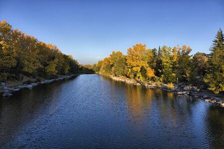 calgary: On a sunny, autumn morning, a calm Bow River in Calgary, Princes Island Park