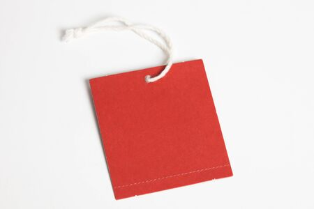 a red tag with white background Фото со стока