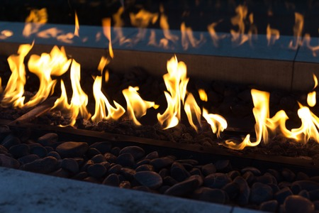 gas fireplace: flame of fire with dark background