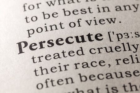 definitions: Fake Dictionary, Dictionary definition of the word persecute Stock Photo