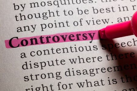 controversy: Dictionary definition of the word controversy. Stock Photo