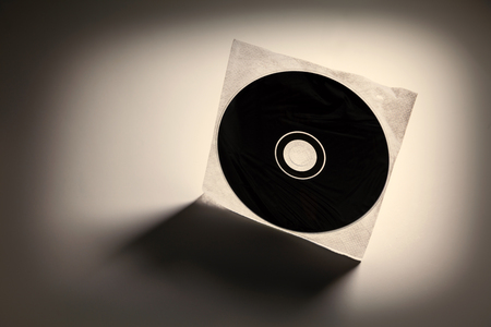 optical disk: a CD, DVD disc with dark shadow Stock Photo