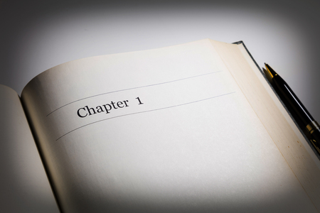 chapter: chapter one, in an open book with a pen Stock Photo
