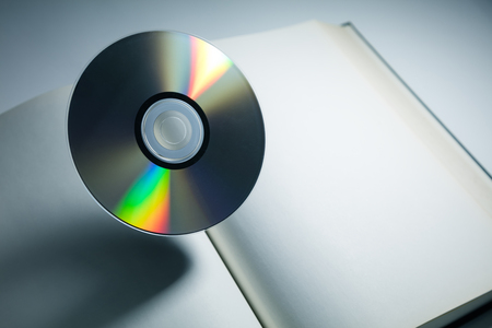 optical disk: Book and DVD disc with dark shadow