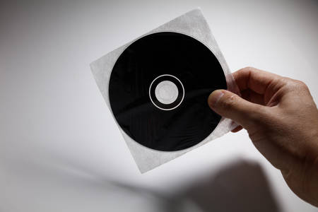optical disk: Hand holding a CD , DVD disk,  technology concept.