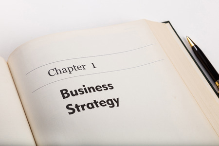 chapter one,  in an open book with a pen, business strategy. fake book. Stock Photo