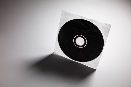 optical disk: a CD , DVD disk with dark shadow ,  technology concept. Stock Photo