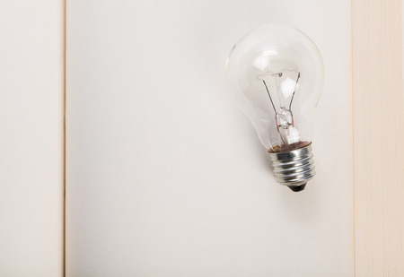 book and light bulb, business education concept.
