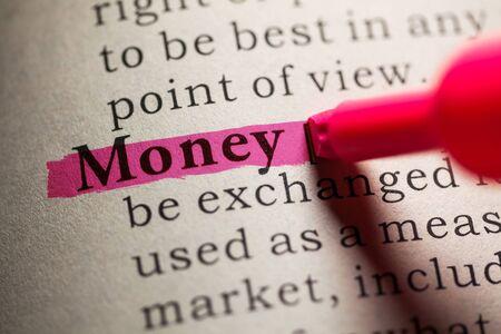 definicion: Falso diccionario, definición de la palabra dinero. Foto de archivo