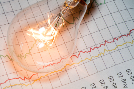 financial gains: business chart and light bulb, business idea concept.