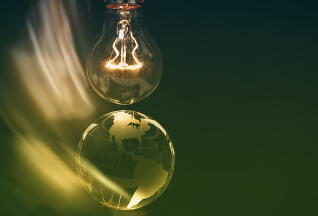 Light bulb and earth, concept of global issues  Stock Photo