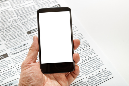 blank screen: Fake newspaper and smartphone with blank screen. business communication concept. Stock Photo