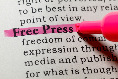 printing out: Fake Dictionary, Dictionary definition of the word free press. including key descriptive words. Stock Photo