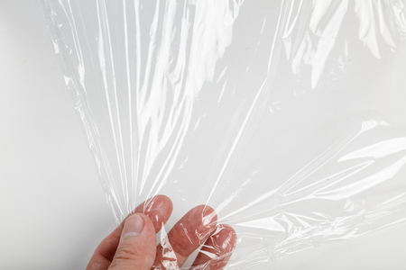 wrapping plastic transparent food film on white background.  Stockfoto