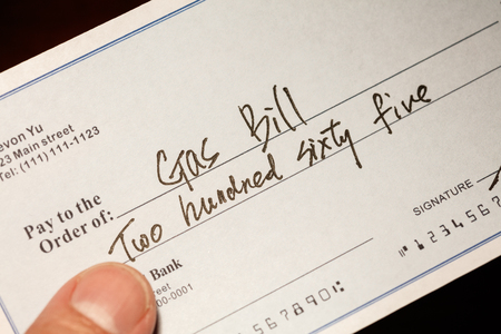 Fake cheque,  cheque for Natural Gas Bill, financial concept.