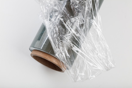wrapping plastic transparent food film on white background.  Stock Photo