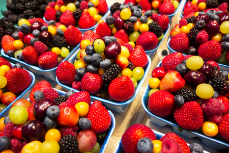 Fresh mixed fruit berries close up background