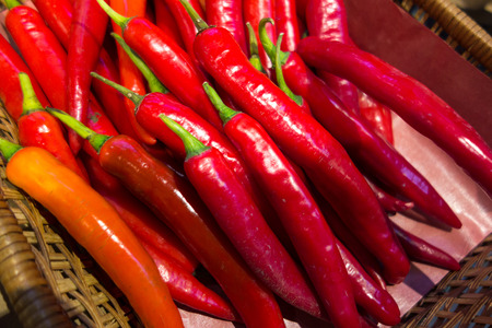 Fresh red chili pepper close up background Imagens