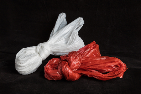 Red Plastic Bag close up with black background Stock Photo