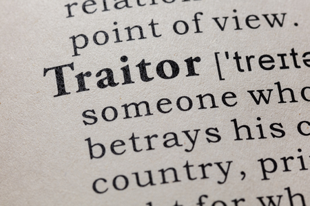 Fake Dictionary, Dictionary definition of the word traitor. including key descriptive words. Stock Photo