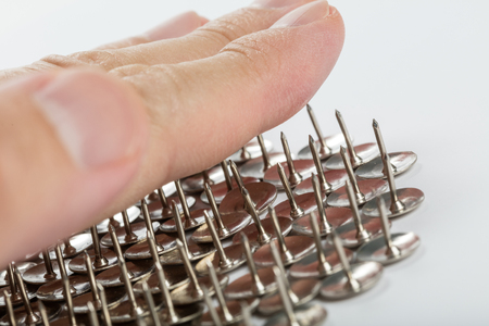 Group Of Metal Thumb Tacks for background