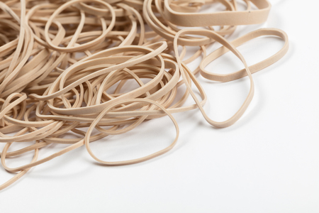 Yellow Rubber Band with white background close up 版權商用圖片