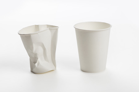 Crumbled White paper coffee cup on white background. Banco de Imagens