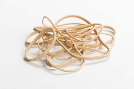 yellow Rubber Band with white background  close up Stock Photo