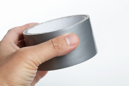 silver repair duct tape with white background 写真素材