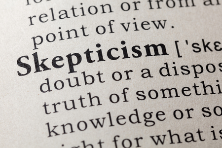 Fake Dictionary, Dictionary definition of the word skepticism. including key descriptive words. Фото со стока