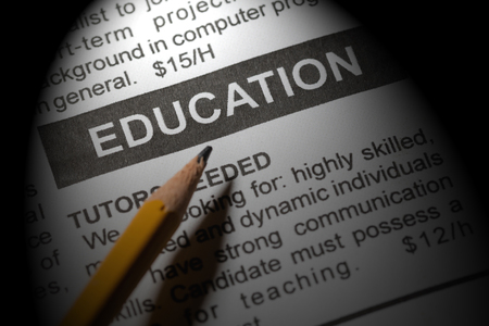 Fake newspaper, newspaper headline  education and pencil