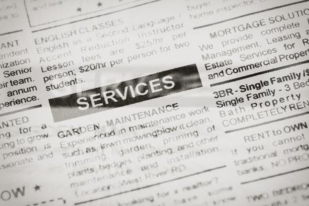 Fake newspaper, newspaper headline services close up
