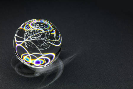 Transparent Crystal ball on black with white light, close up. 版權商用圖片