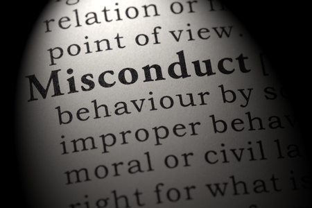Fake dictionary. Dictionary definition of the word misconduct. Including key descriptive words. Stock Photo