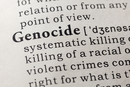Fake dictionary. Dictionary definition of the word genocide. Including key descriptive words.