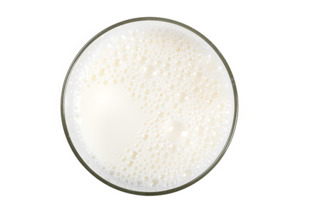 White Milk on glass close up shot isolated on white